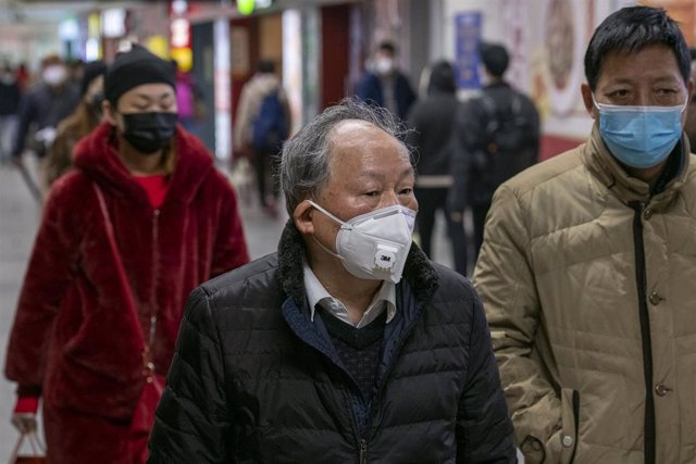 January 24, 2020 - Shanghai, China: Chinese Lunar New Year travellers at South Shanghai Railway Station wear protective face masks in wake of the coronavirus outbreak.