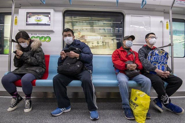 January 24, 2020 - Shanghai, China: Commuters ride the subway wearing protective face masks. There has been a marked increase in the use of such face masks in China in wake of the coronavirus outbreak. Yesterday the Chinese government took the unprecedent