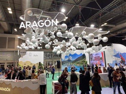 Miles de personas pasan por el stand de Aragón en la Feria Internacional de Turismo en Madrid