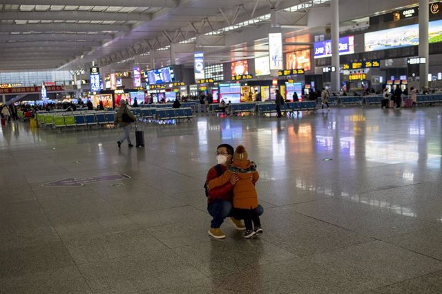 January 27, 2019 - Shanghai, China: A man and his young daughter at Hongqiao Raliaway Station wear protective face masks in wake of the coronavirus outbreak. The station was unusually quiet as many residents stayed indoors to avoid contracting the virus.