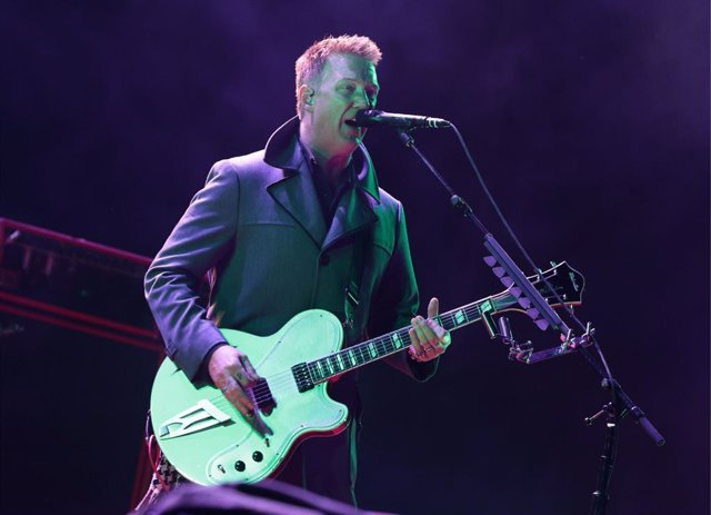 Josh Homme of Queens of the Stone Age performing on the Main Stage, at the Reading Festival, at Little John's Farm on Richfield Avenue, Reading.