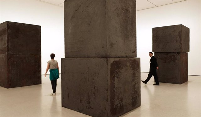"October 21, 2019 - New York, NY USA:  Visitors tour Richard Serra ""Equal"" which consists of eight forged steel boxes stacked in pairs"