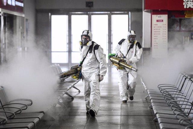 04 February 2020, China, Changsha: Volunteers from Blue Sky Rescue disinfect the Changsha railway station amid the outbreak of the coronavirus. Photo: -/TPG via ZUMA Press/dpa