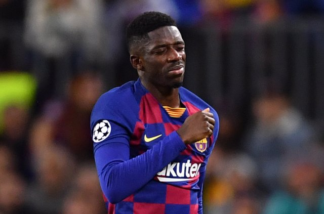 Barcelona's Ousmane Dembele reacts during the UEFA Champions League Group F soceer match between FC Barcelona and Borussia Dortmund at the Camp Nou Stadium.