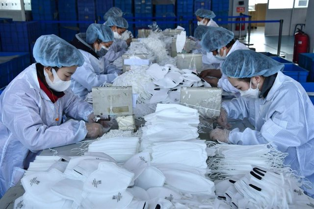 12 February 2020, China, Hebei: workers produces surgical masks at a production line manufacturing masks at a factory, amid the ongoing coronavirus crisis. Photo: Hu Gaolei/SIPA Asia via ZUMA Wire/dpa