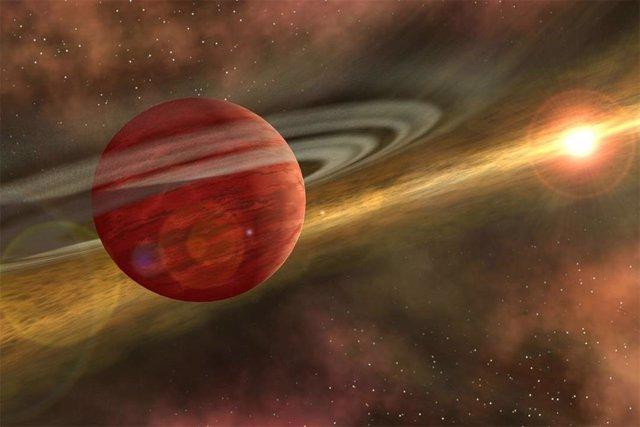 Concepto artístico de un gigante gaseoso orbitando una joven estrella