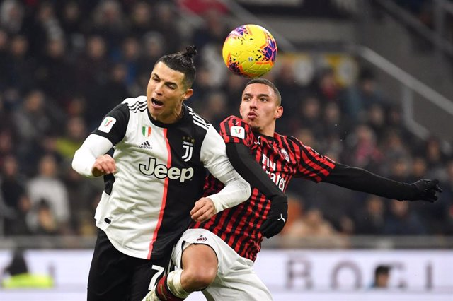 Fútbol.- Cristiano salva un empate contra el Milan en la ida de su semifinal cop
