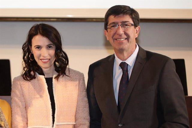 Juan Marín y la directora general de Coordinación de Políticas Migratorias, Mar Ahumada