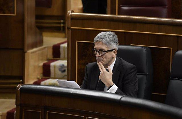 El ministro de Interor, Fernando Grande- Marlaska, durante una sesión plenaria en el Congreso de los Diputados