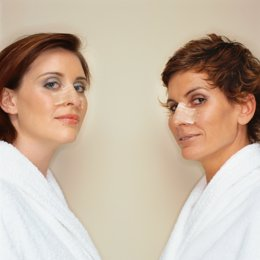 Portrait of two women with bandaged noses