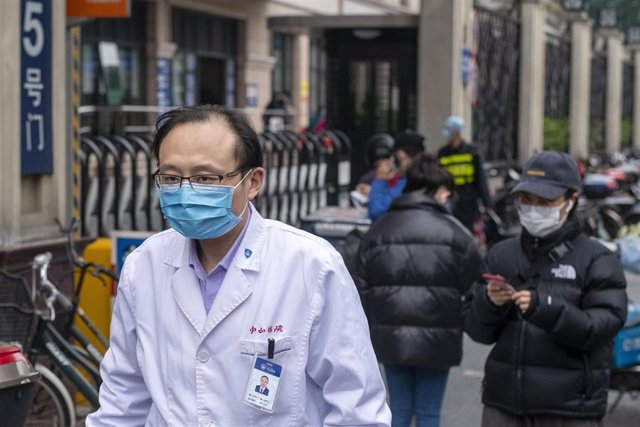 March 3, 2020, Shanghai China - A doctor wears a surgical mask as protection against the coronavirus outsiode Zhongshan Hospital in Xuhui Disrtrict. According to official figures more than 93,000 people have been infected with the virus and at least 3,100