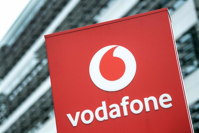 FILED - 16 July 2019, North Rhine-Westphalia, Duesseldorf: The Vodafone logo can be seen in front of the company building in Duesseldorf. Vodafone Idea to increase mobile service rates. Photo: Federico Gambarini/dpa