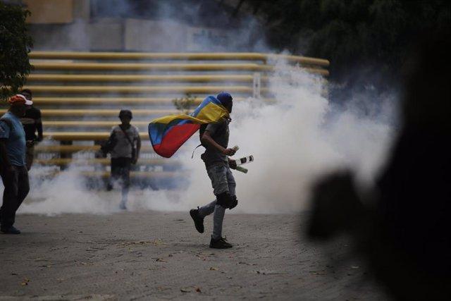 Disturbios en una marcha opositora por Caracas