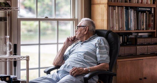 Day Dreaming Elderly Senior Man Staring Through Hazy Window