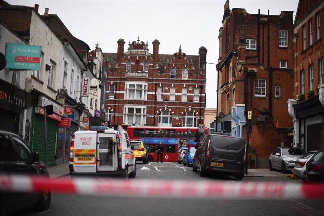 "02 February 2020, England, London: Police seen behind  a caution tape at the scene, where a man has been shot dead by police after he stabbed several people in the south London suburb of Streatham. The incident has been declared as ""terrorist-related"" by"
