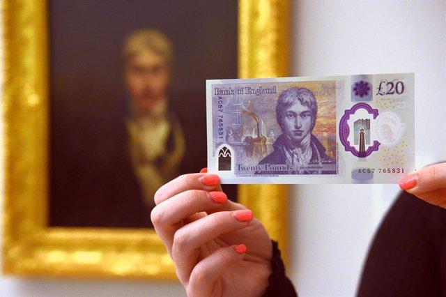 R.Unido.- El Banco de Inglaterra vuelve a bajar tipos por sorpresa y amplía a 21