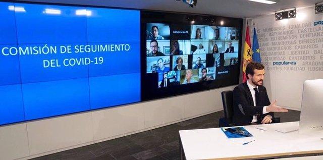 El líder del PP, Pablo Casado, preside la comisión de seguimiento del coronavirus creada por el PP. Madrid, 27 de marzo de 2020.