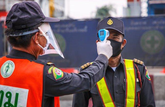 Coronavirus.- Tailandia avanza hacia los 1.500 casos mientras la Policía sofoca