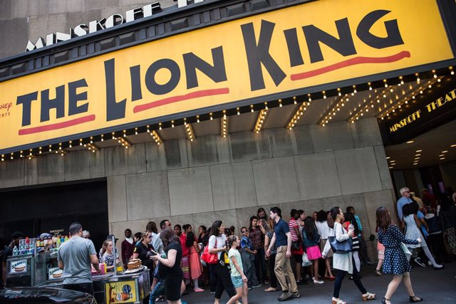 People wait in line to see the matinee show of The Lion King