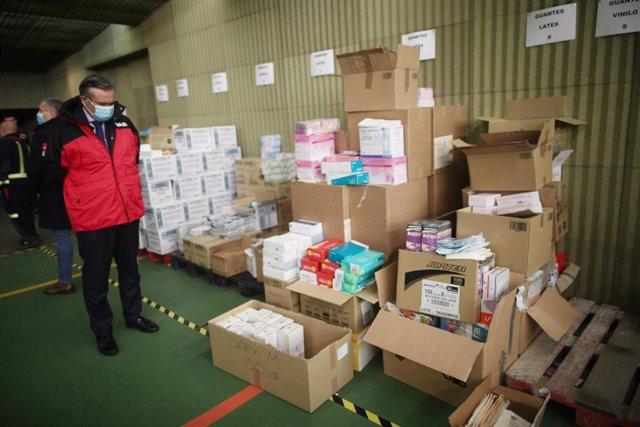 El consejero de Justicia de la Comunidad de Madrid, Enrique López, visita protegido con una mascarilla el centro logístico de la Comunidad de Madrid en el que se recogen las donaciones de material sanitario para lucha contra el coronavirus.