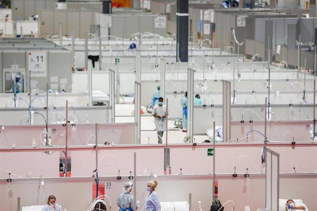 Pacientes de coronavirus en las camas del Hospital temporal de la Comunidad de Madrid habilitado en IFEMA, en Madrid (España) a 31 de marzo de 2020.