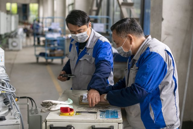 March 31, 2020 - Shanghai China: Workers wear face masks as a precaution against the ongoing Covid-19 outbreak at a factory operated by Buerkle. (Dave Tacon/Contacto)