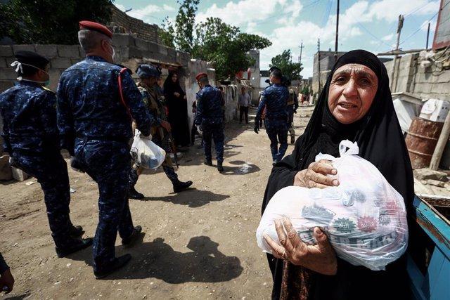Coronavirus.- ACNUR entrega dinero en efectivo a más de 100.000 familias en Irak