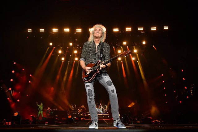 Brian May of Queen performs during the Fire Fight Australia bushfire relief concert at ANZ Stadium in Sydney, Sunday, February 16, 2020. (AAP Image/Joel Carrett) NO ARCHIVING