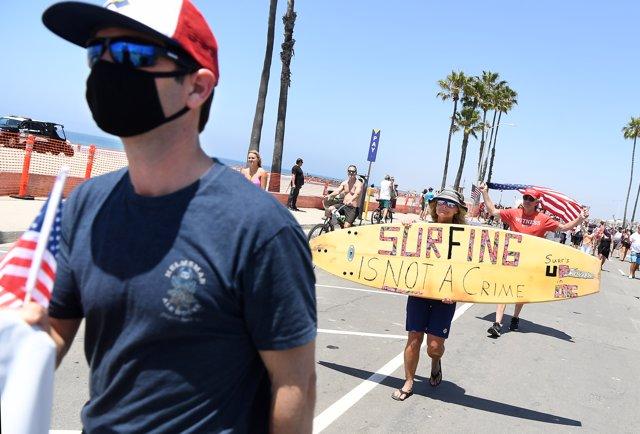 May 2, 2020 - Newport Beach, California, United States: Protestors against beach closures walk in Newport Beach