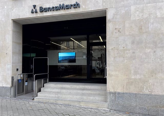 Puerta principal de un local de Banca March en Madrid (España), a 13 de febrero de 2020.