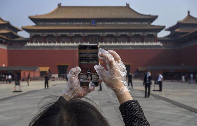 Coronavirus.- China rebaja la alerta en la provincia de Hubei y reabre la Murall