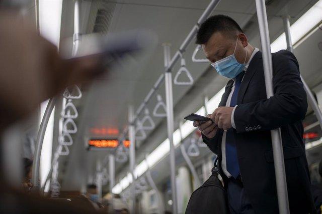 Coronavirus.- La OMS trabaja en enviar una nueva misión a China para buscar el o