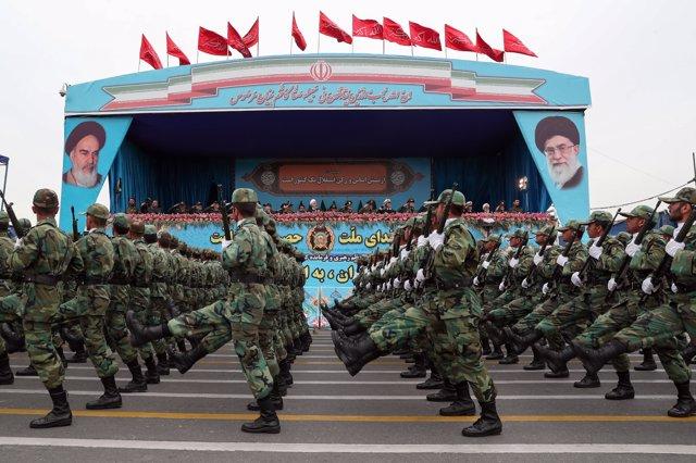 HANDOUT - 18 April 2019, Iran, Tehran: Iranian president Hassan Rouhani (C) attends the annual military parade. Photo: -/Iranian Presidency/dpa