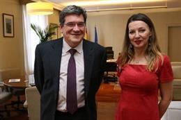 El ministro de Inclusión, Seguridad Social y Migraciones, José Luis Escrivá, y la secretaria general de Uatae, María José Landaburu