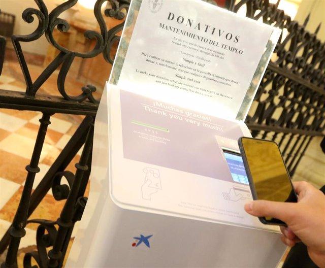 CaixaBank impulsa los donativos digitales en la Basílica de Nuestra Señora del Pilar de Zaragoza.