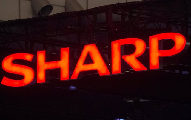 FILED - 04 October 2012, Japan, Chiba: A general view of the logo of Japanese electronics company Sharp at the Ceatec trade fair. Sharp lowered its forecast for sales for the current fiscal year ending 31 March 2020 due to the slow recovery in demand for