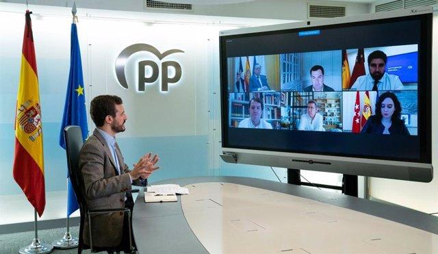 El líder del PP, Pablo Casado, en una reunión por videoconferencia con los presidentes autonómicos de su partido. En  Madrid, a 16 de mayo de 2020.
