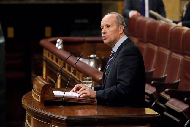 El ministro de Justicia, Juan Carlos Campo, durante su intervención en el debate de convalidación o derogación de los reales decretos-leyes este miércoles en el Congreso. , en Madrid (España), a 13 de mayo de 2020.