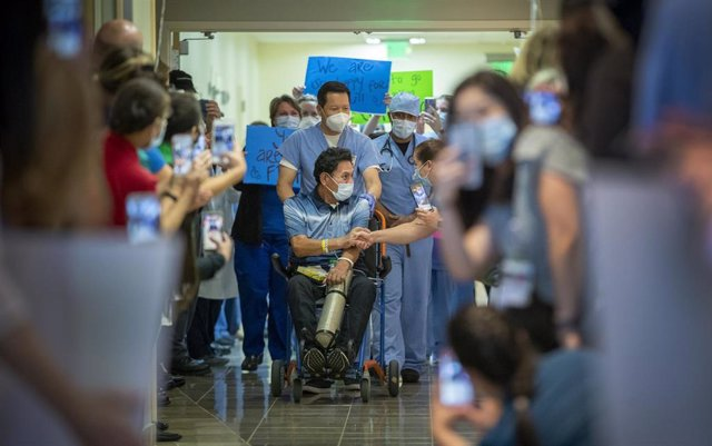 May 5, 2020 - Orange, California, United States: Armando Mendoza, 53, of Anaheim, who was the hospital's second-ever COVID-19 patient, spent 45 days at St. Joseph Hospital, the longest local stint of any COVID-19 patients, is congratulated by a health-car