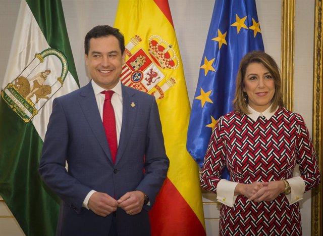 El presidente de la Junta de Andalucía, Juanma Moreno (i), junto a la secretaria general del PSOE de Andalucía, Susana Díaz (d), en una imagen de archivo.