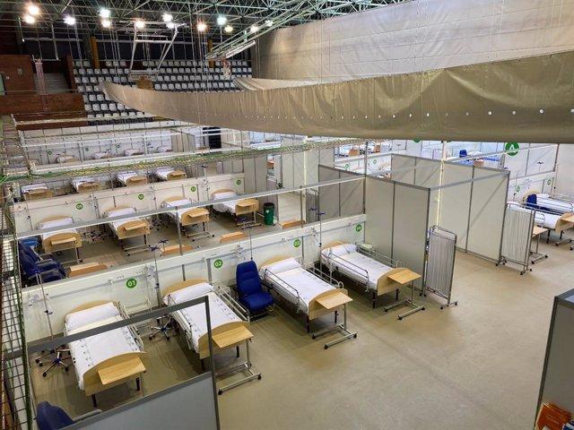 Imagen del pabellón deportivo de Carranque, en Málaga capital, convertido en hospital auxiliar para hacer frente a incremento de casos de coronavirus en caso de ser necesario