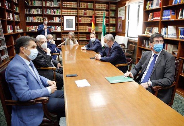El vicepresidente de la Junta y consejero de Turismo, Regeneración, Justicia y Administración Local, Juan Marín, se reúne con el presidente del Tribunal Superior de Justicia de Andalucía (TSJA), Lorenzo del Río, y otras autoridades judiciales.