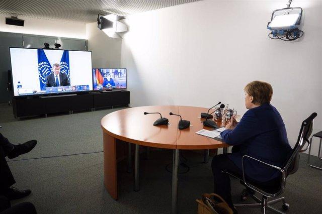 Merkel y líderes financieros alemanes en reunión