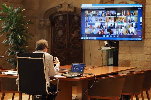 El presidente de la Generalitat, Quim Torra, durante la décimoprimera reunión de presidentes autonómicos con el presidente del Gobierno, Pedro Sánchez.