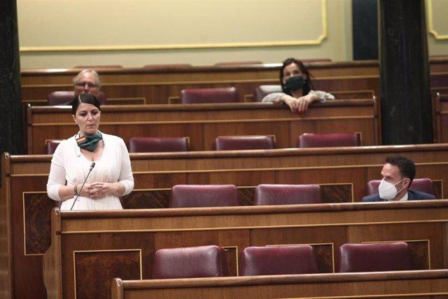 La diputada y portavoz adjunta de Vox en el Congreso, Macarena Olona, interviene en el pleno de control al Gobierno del 27 de mayo