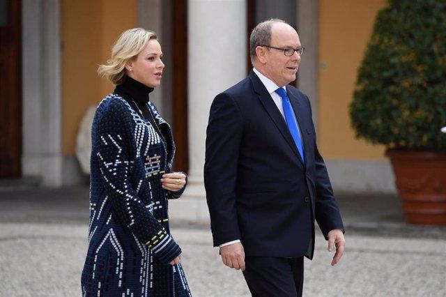 Princess Charlene of Monaco and Prince Albert II of Monaco attend the Christmas Gifts Distribution At Monaco Palace