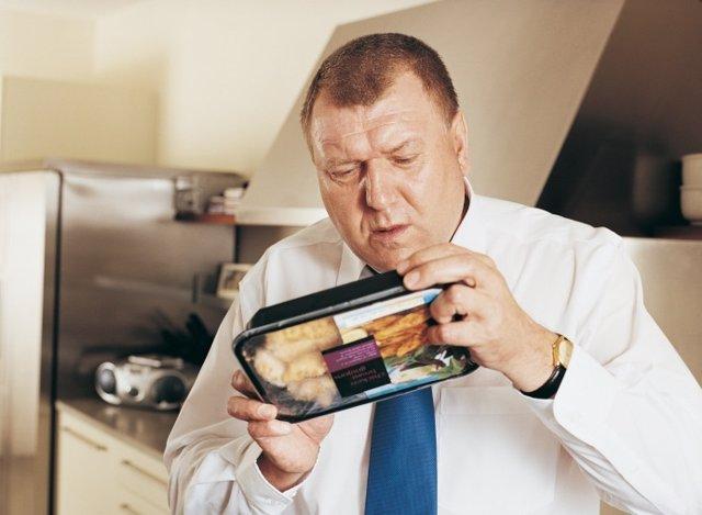 Man Holding Reading Label on Food