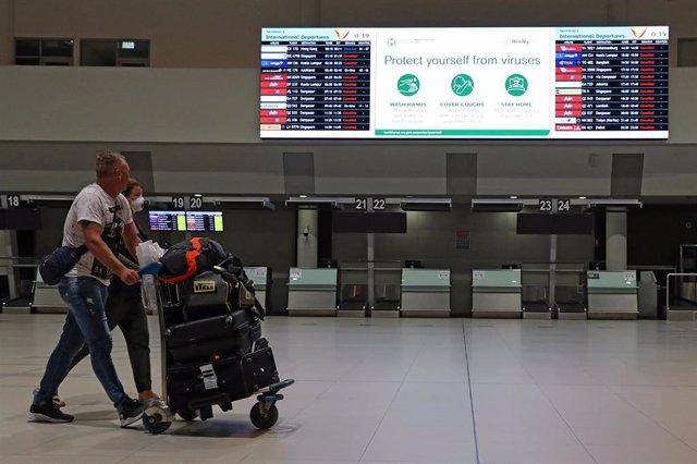 Pasajeros neozelandeses en el aeropuerto de Perth, en el oeste de Australia.