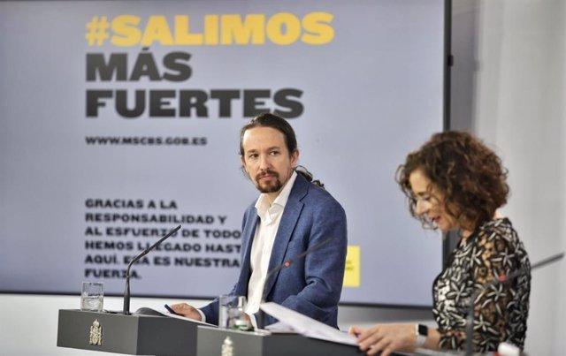 El vicepresidente segundo, Pablo Iglesias, y la portavoz del Gobierno, María Jesús Montero