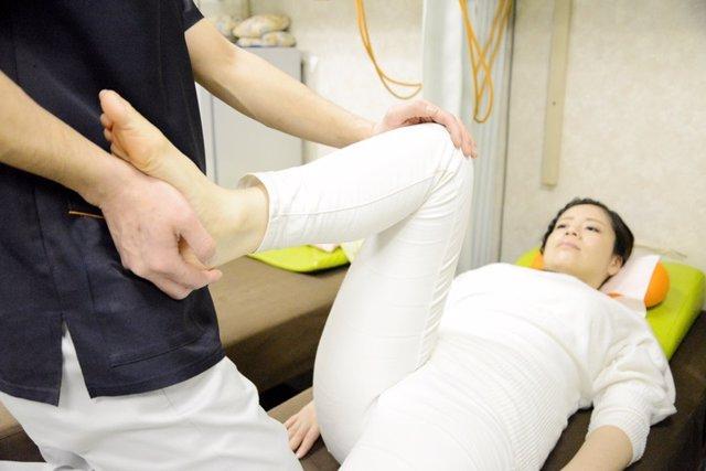 Woman receiving osteopathy